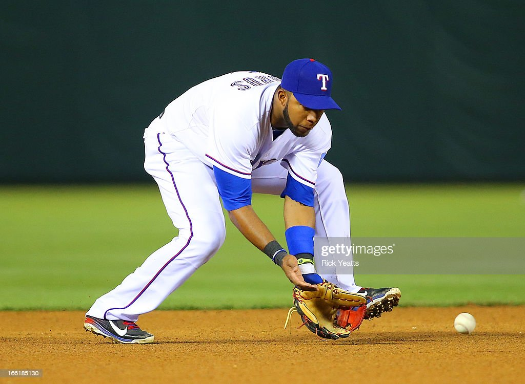 <a gi-track='captionPersonalityLinkClicked' href=/galleries/search?phrase=Elvis+Andrus&family=editorial&specificpeople=4845974 ng-click='$event.stopPropagation()'>Elvis Andrus</a> #1 of the Texas Rangers fields a ground ball to turn a double play against the Tampa Bay Rays at Rangers Ballpark in Arlington on April 9, 2013 in Arlington, Texas.
