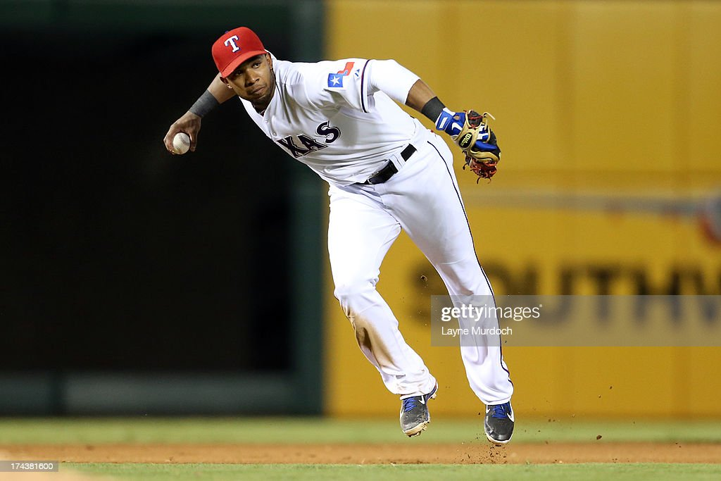 <a gi-track='captionPersonalityLinkClicked' href=/galleries/search?phrase=Elvis+Andrus&family=editorial&specificpeople=4845974 ng-click='$event.stopPropagation()'>Elvis Andrus</a> #1 of the Texas Rangers fields the ball against the New York Yankees on July 24, 2013 at the Rangers Ballpark in Arlington in Arlington, Texas.
