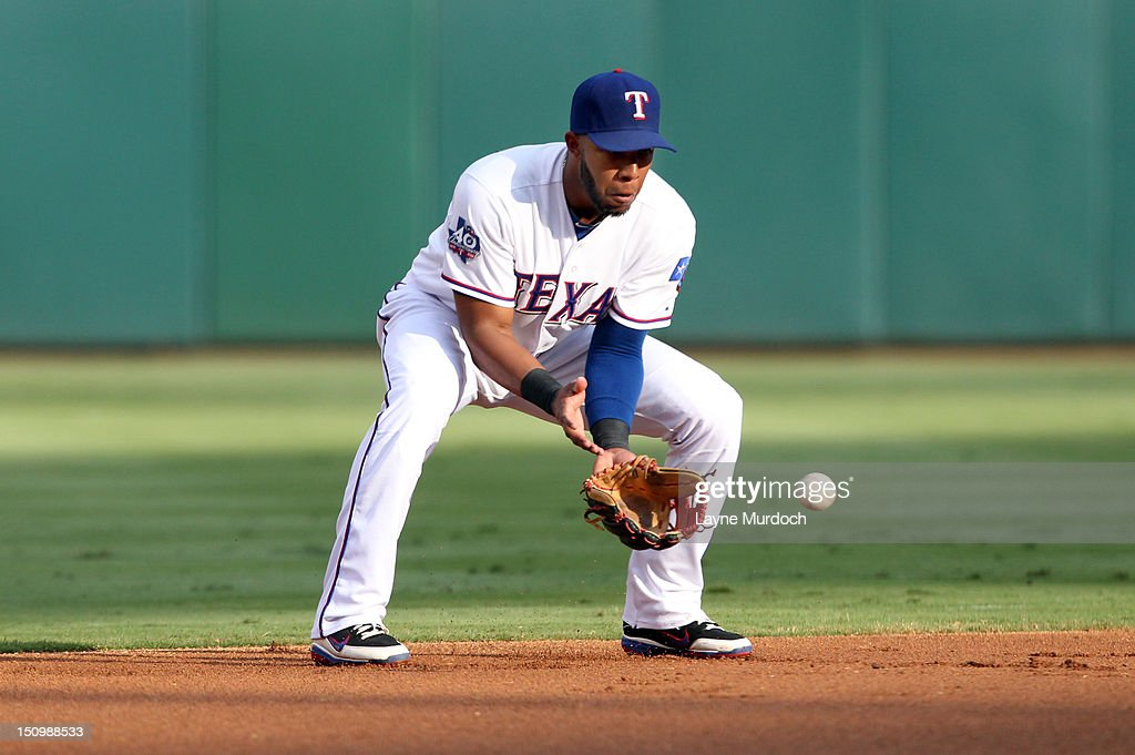 <a gi-track='captionPersonalityLinkClicked' href=/galleries/search?phrase=Elvis+Andrus&family=editorial&specificpeople=4845974 ng-click='$event.stopPropagation()'>Elvis Andrus</a> #1 of the Texas Rangers fields the hit and throws out Elliot Johnson of the Tampa Bay Rays at first base in the top of the first inning on August 29, 2012 at the Rangers Ballpark in Arlington in Arlington, Texas.