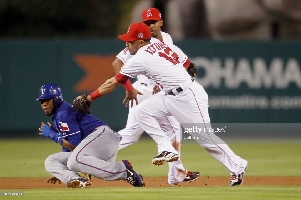 <a gi-track='captionPersonalityLinkClicked' href=/galleries/search?phrase=Elvis+Andrus&family=editorial&specificpeople=4845974 ng-click='$event.stopPropagation()'>Elvis Andrus</a> #1 of the Texas Rangers is tagged out by second baseman <a gi-track='captionPersonalityLinkClicked' href=/galleries/search?phrase=Maicer+Izturis&family=editorial&specificpeople=239100 ng-click='$event.stopPropagation()'>Maicer Izturis</a> #13 of the Los Angeles Angels of Anaheim after being caught in a run down in the first inning at Angel Stadium of Anaheim on September 26, 2011 in Anaheim, California.