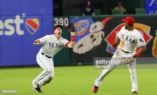 Elvis Andrus of the Texas Rangers looks on as Ryan Rua fields a fly ball in the eighth inning against the Houston Astros at Globe Life Park in...