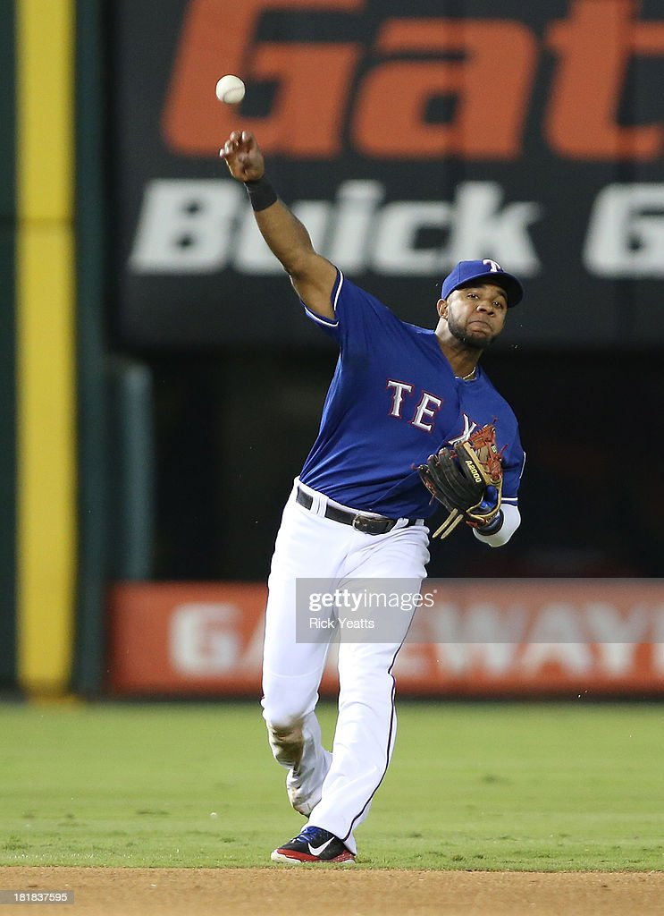 Elvis Andrus #1 of the Texas Rangers makes a late throw to first base against runner Jose Altuve #27 of the Houston Astros at Rangers Ballpark in Arlington on September 25, 2013 in Arlington, Texas.