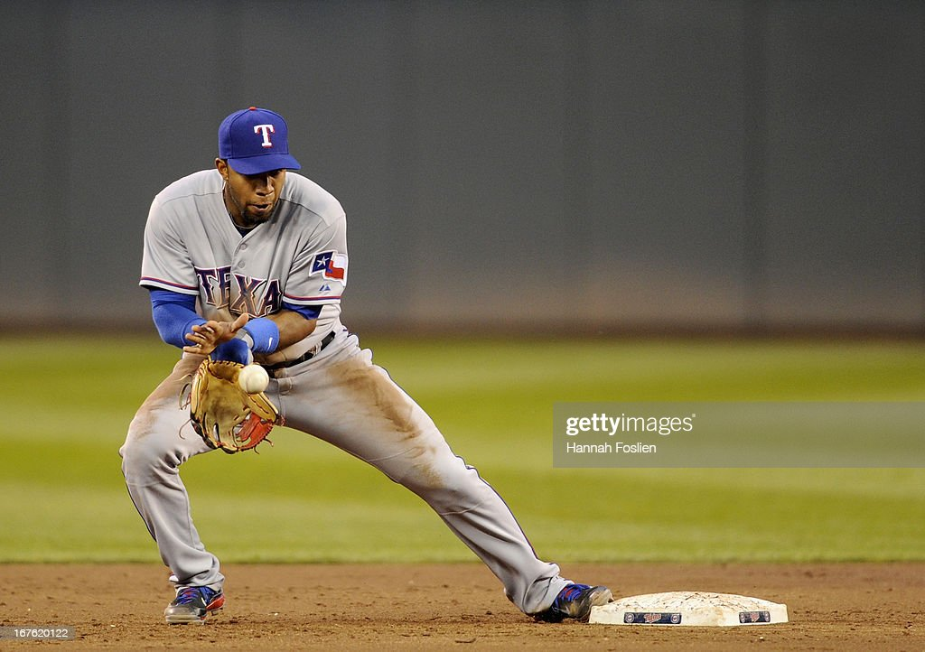 Elvis Andrus #1 of the Texas Rangers makes fields the ball to start a double play during the third inning of the game against the Minnesota Twins on April 26, 2013 at Target Field in Minneapolis, Minnesota.
