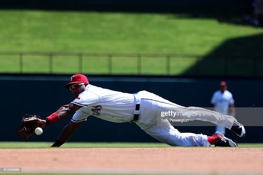 Elvis Andrus #1 of the Texas Rangers misses fielding a ground ball single hit by Logan Forsythe #11 of the Tampa Bay Rays in the top of the second inning at Globe Life Park in Arlington on October 2, 2016 in Arlington, Texas.