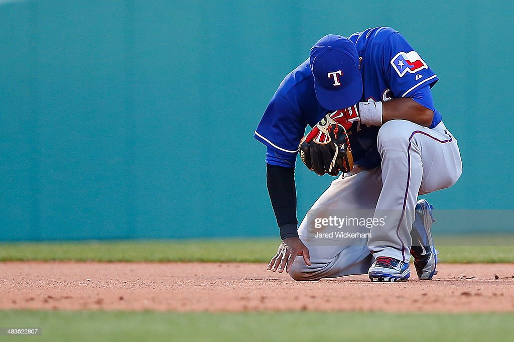 Elvis Andrus of the Texas Rangers reacts after mishandling a ground ball against the Boston Red Sox at Fenway Park on April 9 2014 in Boston...