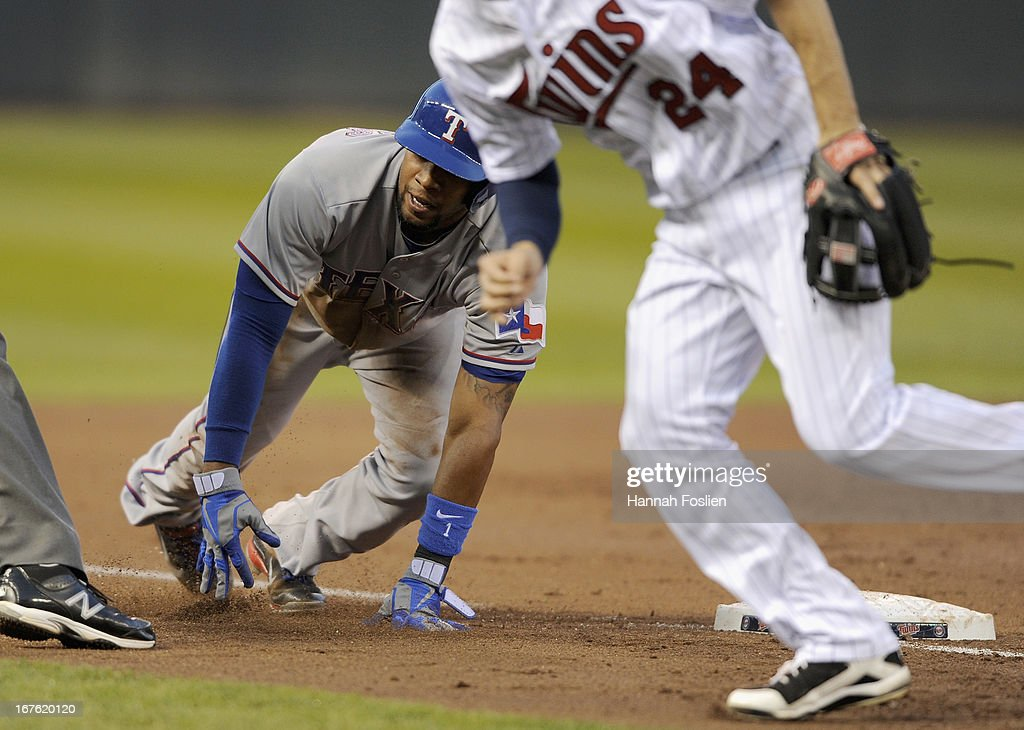 Elvis Andrus #1 of the Texas Rangers reacts at third base after the ball gets past Trevor Plouffe #24 of the Minnesota Twins during the third inning of the game on April 26, 2013 at Target Field in Minneapolis, Minnesota.