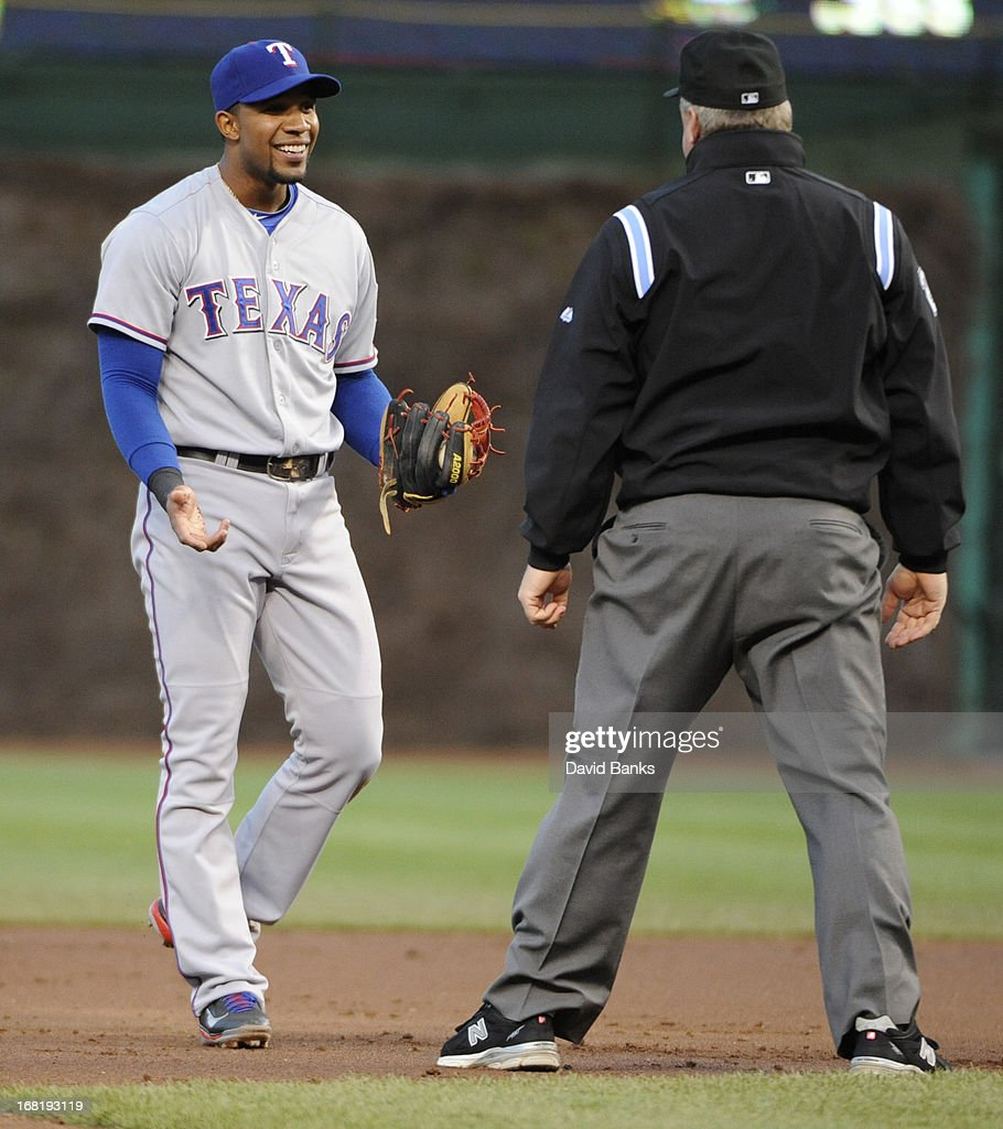 <a gi-track='captionPersonalityLinkClicked' href=/galleries/search?phrase=Elvis+Andrus&family=editorial&specificpeople=4845974 ng-click='$event.stopPropagation()'>Elvis Andrus</a> #1 of the Texas Rangers reacts to call by umpire Bill Miller #26 in a game against the Chicago Cubs during the first inning on May 6, 2013 at Wrigley Field in Chicago, Illinois.