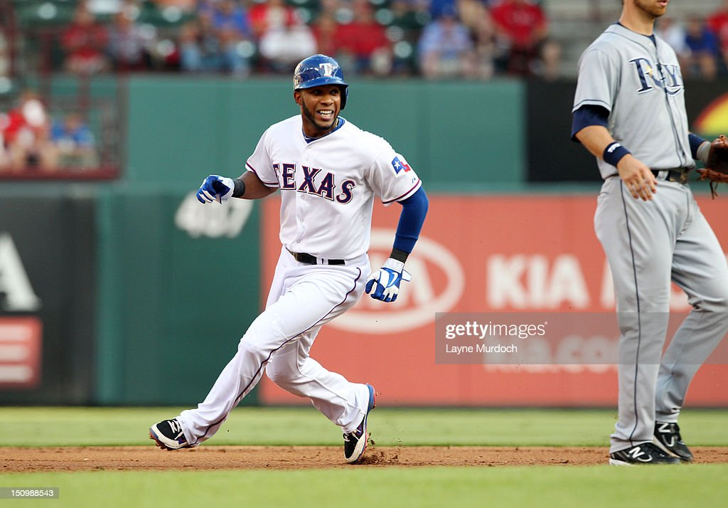 <a gi-track='captionPersonalityLinkClicked' href=/galleries/search?phrase=Elvis+Andrus&family=editorial&specificpeople=4845974 ng-click='$event.stopPropagation()'>Elvis Andrus</a> #1 of the Texas Rangers rounds second base on a wild pitch by Alex Cobb of the Tampa Bay Rays on August 29, 2012 at the Rangers Ballpark in Arlington in Arlington, Texas.