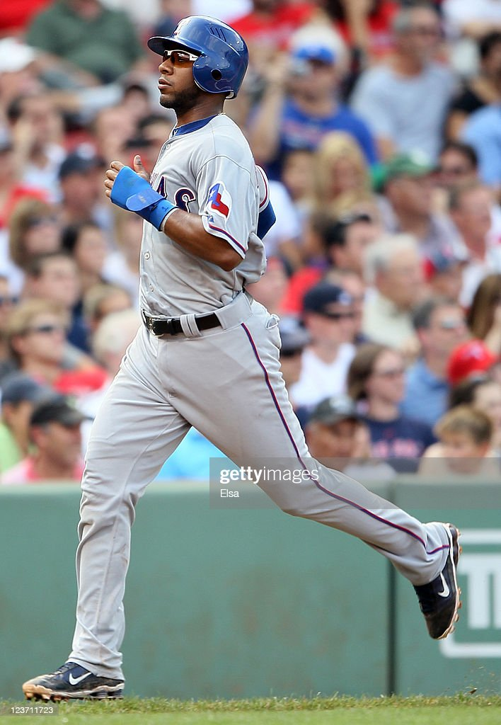 <a gi-track='captionPersonalityLinkClicked' href=/galleries/search?phrase=Elvis+Andrus&family=editorial&specificpeople=4845974 ng-click='$event.stopPropagation()'>Elvis Andrus</a> #1 of the Texas Rangers scores a run in the sixth inning against the Boston Red Sox on September 4, 2011 at Fenway Park in Boston, Massachusetts.