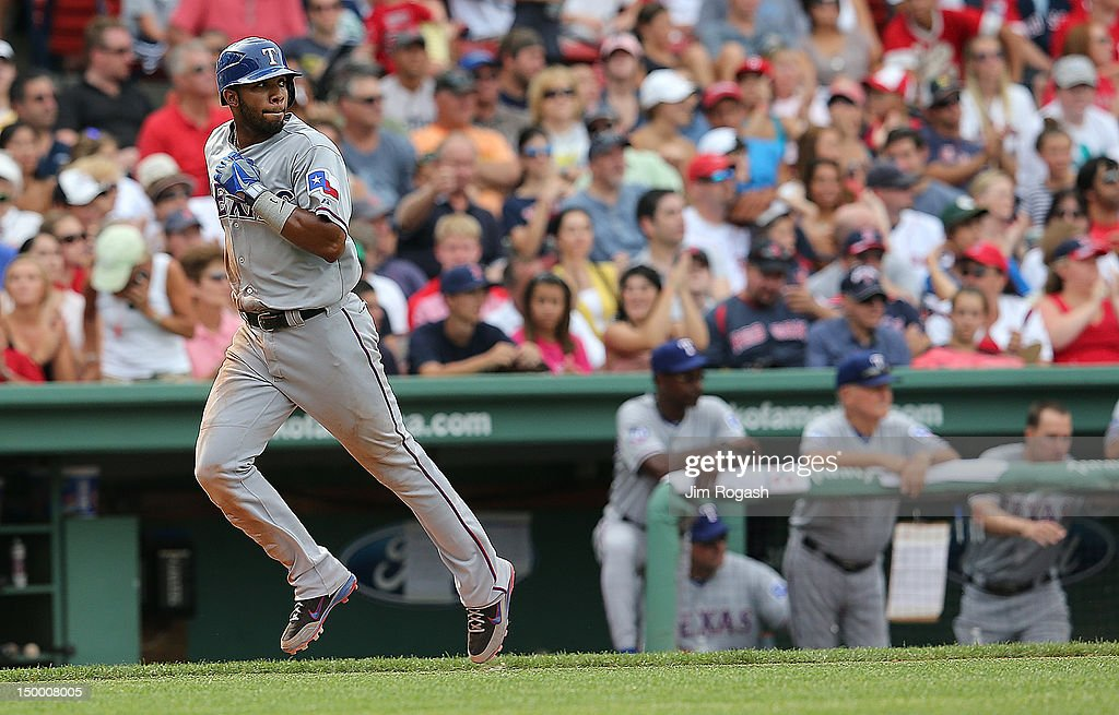 Elvis Andrus #1 of the Texas Rangers scores a run on a sacrifice fly in the ninth inning against the Boston Red Sox at Fenway Park August 8, 2012 in Boston, Massachusetts.