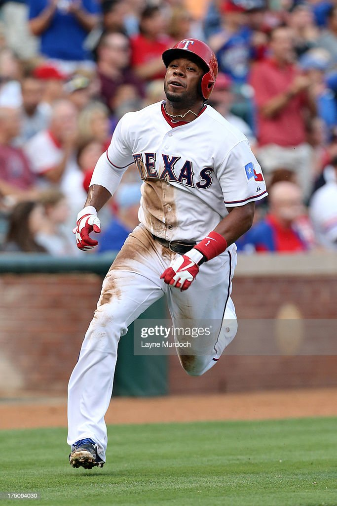 <a gi-track='captionPersonalityLinkClicked' href=/galleries/search?phrase=Elvis+Andrus&family=editorial&specificpeople=4845974 ng-click='$event.stopPropagation()'>Elvis Andrus</a> #1 of the Texas Rangers scores on a hit by teammate Ian Kinsler against the Los Angeles Angels of Anaheim on July 30, 2013 at the Rangers Ballpark in Arlington in Arlington, Texas.