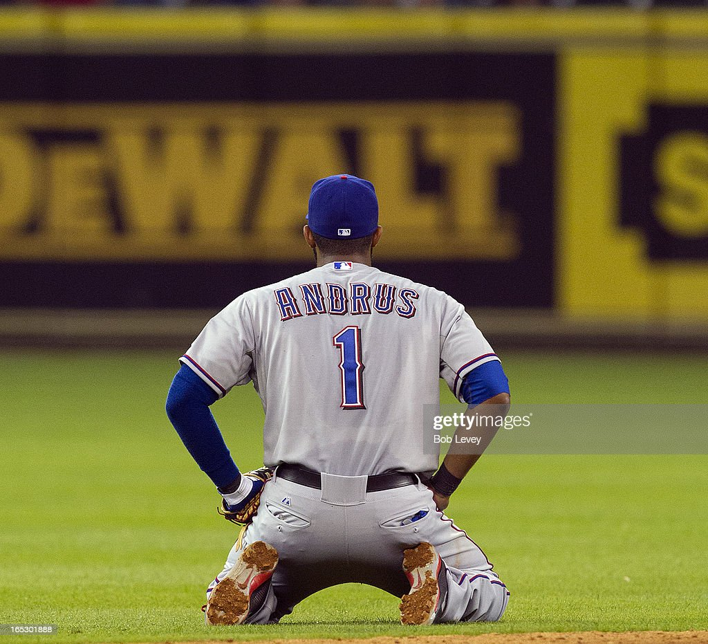 <a gi-track='captionPersonalityLinkClicked' href=/galleries/search?phrase=Elvis+Andrus&family=editorial&specificpeople=4845974 ng-click='$event.stopPropagation()'>Elvis Andrus</a> #1 of the Texas Rangers sits on his knees after he was unable to keep a line drive in the ninth inning hit by Marwin Gonzalez #9 of the Houston Astros (not pictured) from going into centerfield, breaking up a perfect game for Yu Darvish #11, at Minute Maid Park on April 2, 2013 in Houston, Texas.