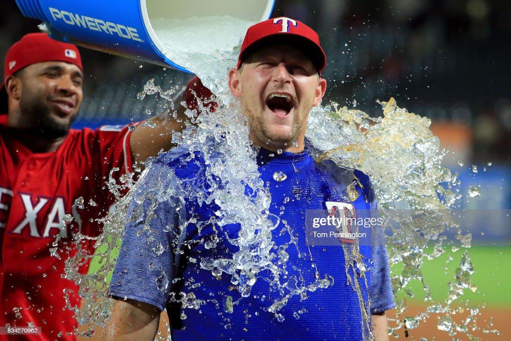 Elvis Andrus #1 of the Texas Rangers soaks Austin Bibens-Dirkx #56 of the Texas Rangers with a water cooler after the Texas Rangers beat the Chicago White Sox 9-8 at Globe Life Park in Arlington on August 17, 2017 in Arlington, Texas.
