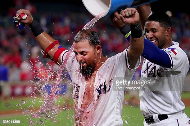 Elvis Andrus of the Texas Rangers soaks Rougned Odor of the Texas Rangers with the Powerade cooler after Odor hit a tworun walkoff homerun against...