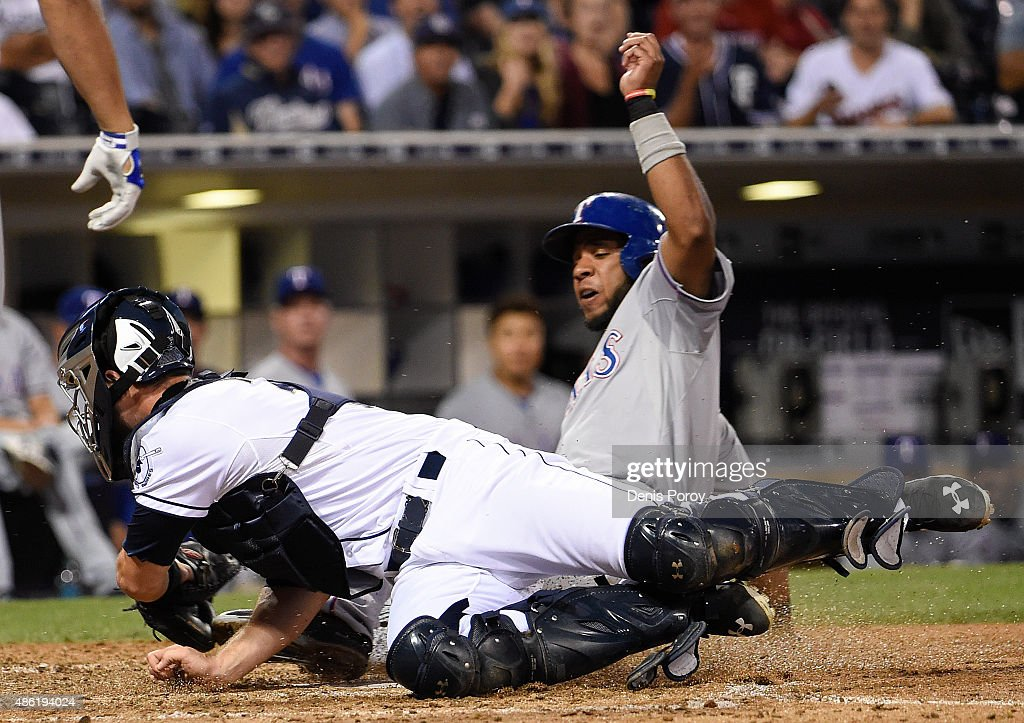 <a gi-track='captionPersonalityLinkClicked' href=/galleries/search?phrase=Elvis+Andrus&family=editorial&specificpeople=4845974 ng-click='$event.stopPropagation()'>Elvis Andrus</a> #1 of the Texas Rangers steals home ahead of the tag of Austin Hedges #18 of the San Diego Padres during the seventh inning of a baseball game at Petco Park September, 1, 2015 in San Diego, California.