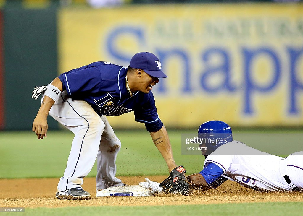 <a gi-track='captionPersonalityLinkClicked' href=/galleries/search?phrase=Elvis+Andrus&family=editorial&specificpeople=4845974 ng-click='$event.stopPropagation()'>Elvis Andrus</a> #1 of the Texas Rangers steals second base in the fifth inning against <a gi-track='captionPersonalityLinkClicked' href=/galleries/search?phrase=Yunel+Escobar&family=editorial&specificpeople=757358 ng-click='$event.stopPropagation()'>Yunel Escobar</a> #11 of the Tampa Bay Rays at Rangers Ballpark in Arlington on April 9, 2013 in Arlington, Texas.