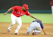 Elvis Andrus of the Texas Rangers tags out Juan Centeno of the Minnesota Twins in a run down in the seventh inning at Globe Life Park in Arlington on...