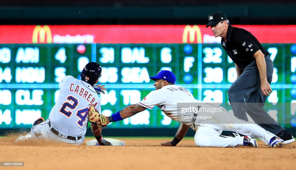 Elvis Andrus #1 of the Texas Rangers tags out Miguel Cabrera #24 of the Detroit Tigers at second base in the top of the seventh inning at Globe Life Park in Arlington on August 16, 2017 in Arlington, Texas.