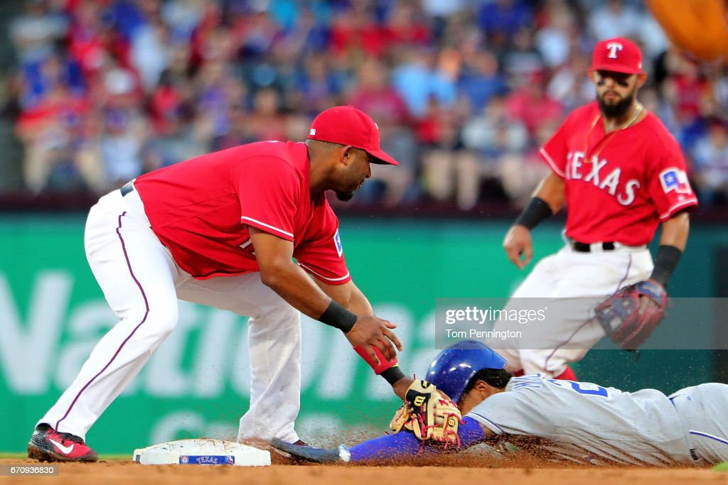 Elvis Andrus #1 of the Texas Rangers tags out Raul Mondesi #27 of the Kansas City Royals at second base in the top of the third inning at Globe Life Park in Arlington on April 20, 2017 in Arlington, Texas.