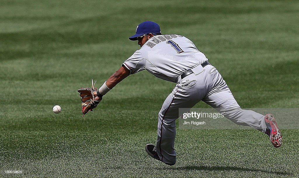 Elvis Andrus #1 of the Texas Rangers tracks down a ground ball against the Boston Red Sox at Fenway Park August 8, 2012 in Boston, Massachusetts.