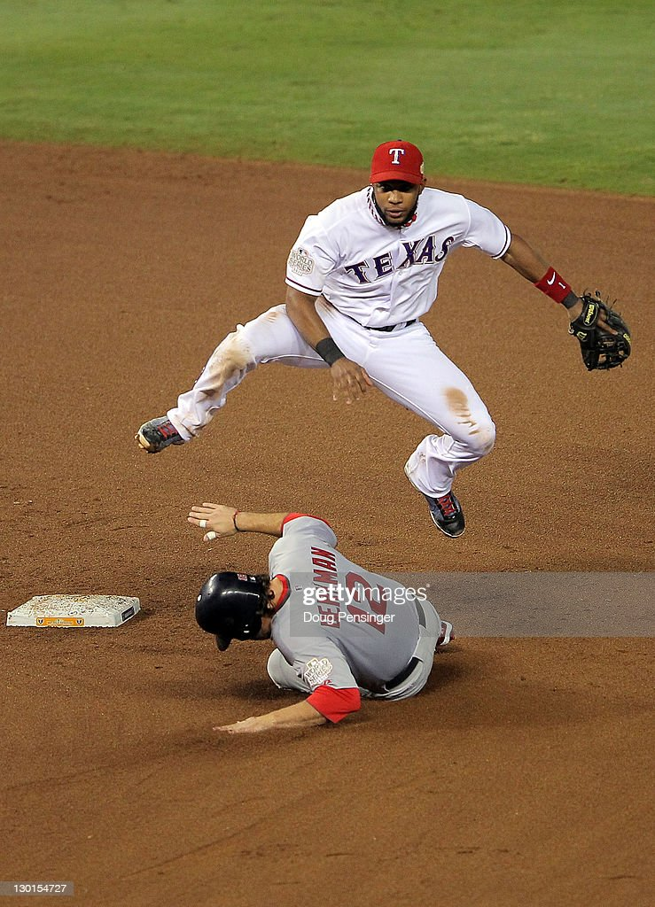 <a gi-track='captionPersonalityLinkClicked' href=/galleries/search?phrase=Elvis+Andrus&family=editorial&specificpeople=4845974 ng-click='$event.stopPropagation()'>Elvis Andrus</a> #1 of the Texas Rangers turns the double play as <a gi-track='captionPersonalityLinkClicked' href=/galleries/search?phrase=Lance+Berkman&family=editorial&specificpeople=167176 ng-click='$event.stopPropagation()'>Lance Berkman</a> #12 of the St. Louis Cardinals slides into second base in the fifth inning during Game Four of the MLB World Series at Rangers Ballpark in Arlington on October 23, 2011 in Arlington, Texas.