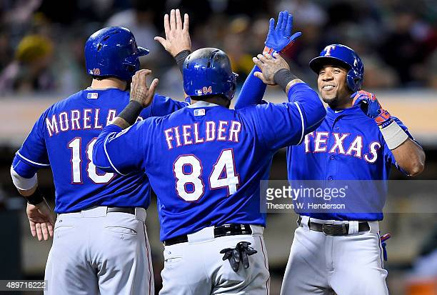 Elvis Andrus Prince Fielder and Mitch Moreland of the Texas Rangers celebrate Andrus' threerun homer against the Oakland Athletics in the top of the...