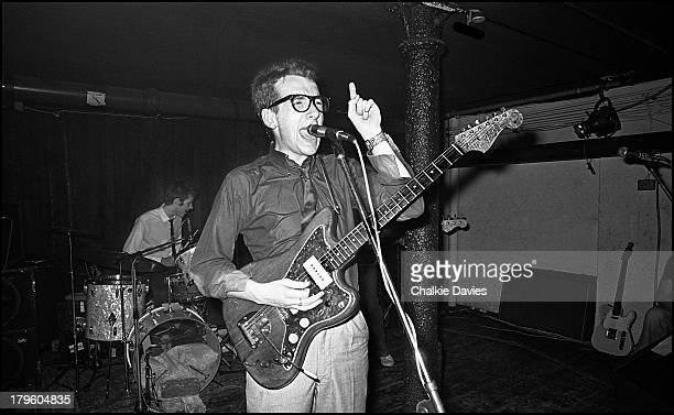 Elvis Costello and the Attractions perform at Dingwalls in London on 26th July 1977 Drummer Pete Thomas is in the background left