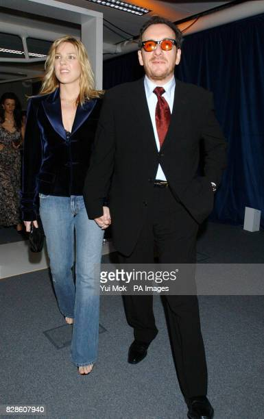 Elvis Costello jazz singer Diana Krall attend a party at The Old Billingsgate Fish Market London following Sir Elton John's benefit gig at the Old...