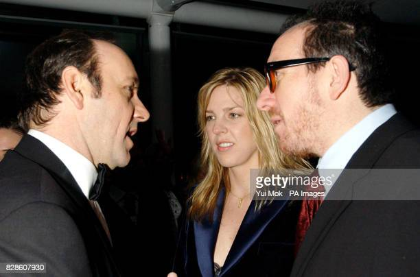 Elvis Costello jazz singer Diana Krall talk to Kevin Spacey during the party at The Old Billingsgate Fish Market London following Sir Elton John's...