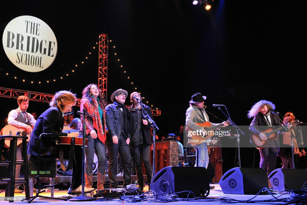 Elvis Costello, Neil Young and Jim James (C-R) perform on Day 2 of the 27th Annual Bridge School Benefit concert at Shoreline Amphitheatre on October 27, 2013 in Mountain View, California.