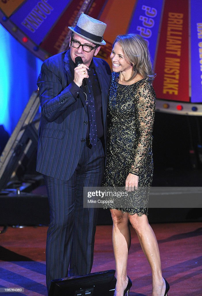<a gi-track='captionPersonalityLinkClicked' href=/galleries/search?phrase=Elvis+Costello&family=editorial&specificpeople=206830 ng-click='$event.stopPropagation()'>Elvis Costello</a> performs with <a gi-track='captionPersonalityLinkClicked' href=/galleries/search?phrase=Katie+Couric&family=editorial&specificpeople=202633 ng-click='$event.stopPropagation()'>Katie Couric</a> onstage at the 2012 A Funny Thing Happened On The Way To Cure Parkinson's event at The Waldorf=Astoria on November 10, 2012 in New York City benefitting The Michael J. Fox Foundation for Parkinson's Research.