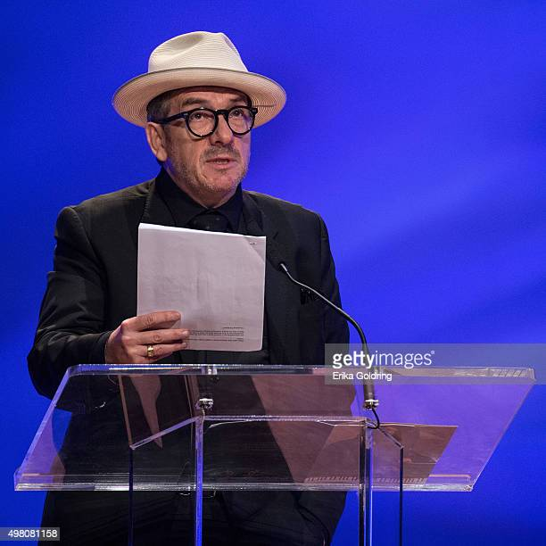 Elvis Costello speaks at Allen Toussaint's funeral at The Orpheum Theatre on November 20 2015 in New Orleans Louisiana