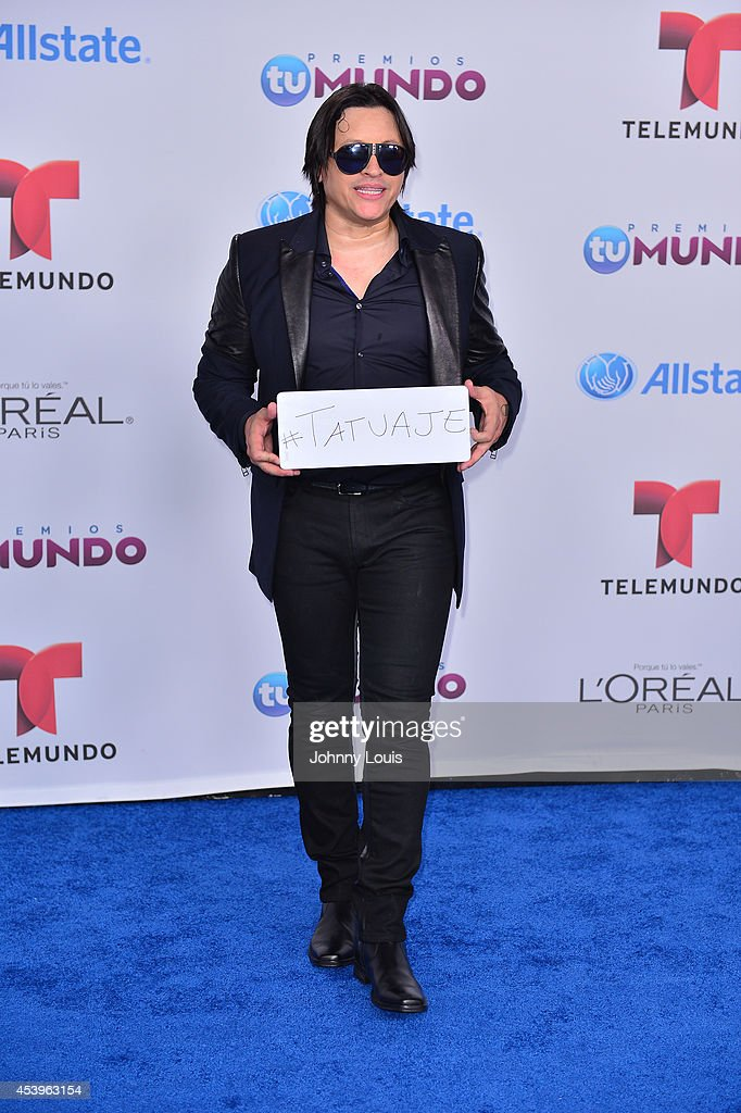 <a gi-track='captionPersonalityLinkClicked' href=/galleries/search?phrase=Elvis+Crespo&family=editorial&specificpeople=224534 ng-click='$event.stopPropagation()'>Elvis Crespo</a> arrives at Telemundo's Premios Tu Mundo Awards 2014 at American Airlines Arena on August 21, 2014 in Miami, Florida.