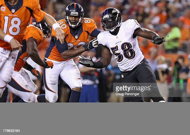Elvis Dumervil beats the block of Julius Thomas of the Denver Broncos during the NFL season opener at Sports Authority Field at Mile High on...