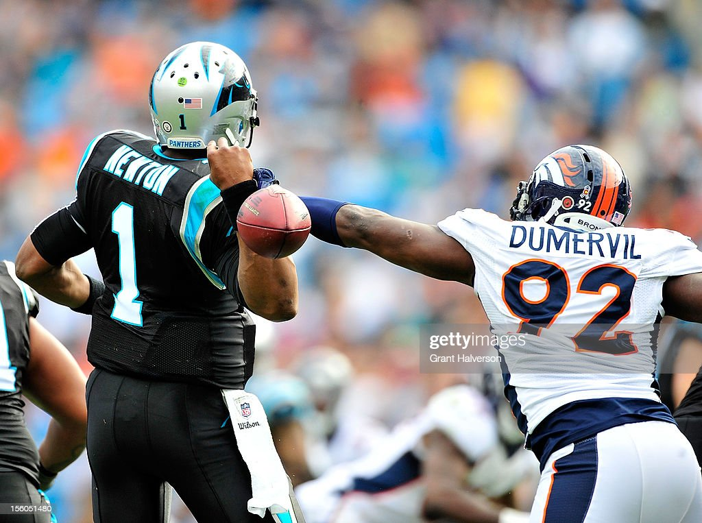 Elvis Dumervil #92 of the Denver Broncos strips the ball from Cam Newton #1 of the Carolina Panthers during play at Bank of America Stadium on November 11, 2012 in Charlotte, North Carolina.