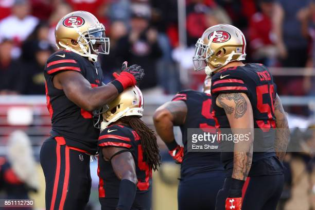Elvis Dumervil of the San Francisco 49ers celebrates after a play against the Los Angeles Rams during their NFL game at Levi's Stadium on September...