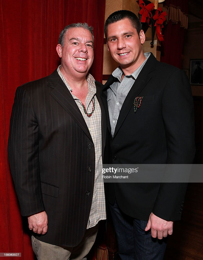 <a gi-track='captionPersonalityLinkClicked' href=/galleries/search?phrase=Elvis+Duran&family=editorial&specificpeople=3048281 ng-click='$event.stopPropagation()'>Elvis Duran</a> (L) and Alex Carr attend <a gi-track='captionPersonalityLinkClicked' href=/galleries/search?phrase=Elvis+Duran&family=editorial&specificpeople=3048281 ng-click='$event.stopPropagation()'>Elvis Duran</a> Morning Show Holiday Party at Carmine's on December 14, 2012 in New York City.