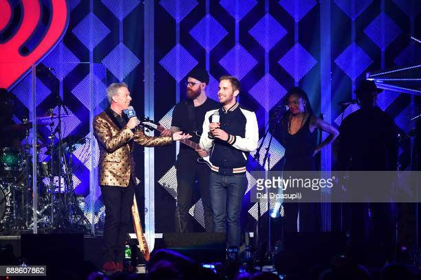 Elvis Duran and Ben Platt speak onstage at the Z100's Jingle Ball 2017 on December 8 2017 in New York City