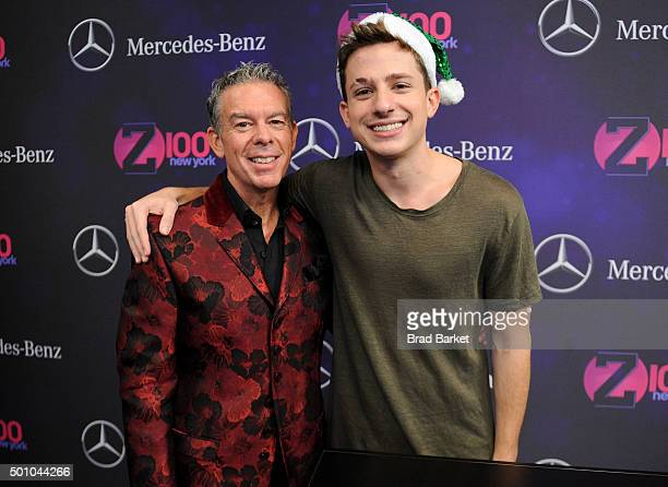 Elvis Duran and Charlie Puth attend Z100's Jingle Ball 2015 at Madison Square Garden on December 11 2015 in New York City