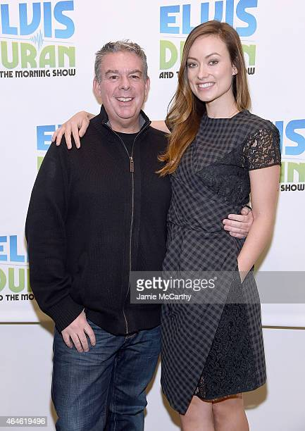 Elvis Duran and Olivia Wilde pose for a photo during 'The Elvis Duran Z100 Morning Show' at Z100 Studio on February 26 2015 in New York City