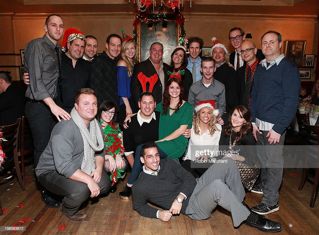 Elvis Duran (C) and the Morning Show staff attend Elvis Duran Morning Show Holiday Party at Carmine's on December 14, 2012 in New York City.