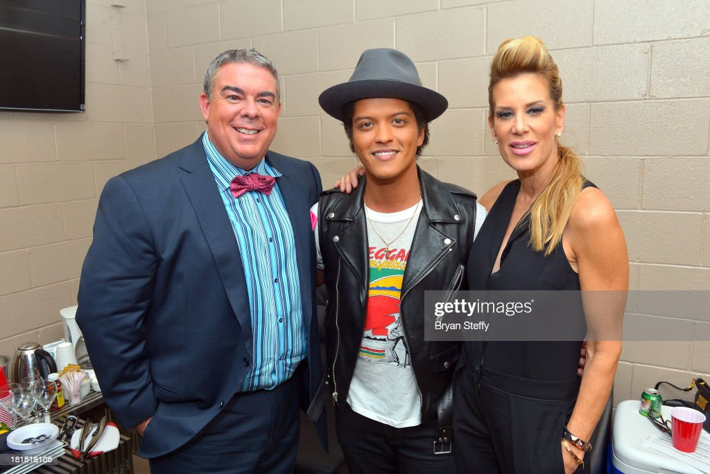 Elvis Duran, Bruno Mars and Ellen K attend the iHeartRadio Music Festival at the MGM Grand Garden Arena on September 21, 2013 in Las Vegas, Nevada.