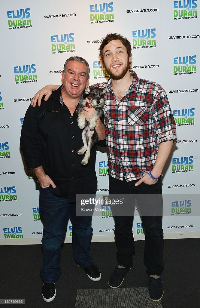 <a gi-track='captionPersonalityLinkClicked' href=/galleries/search?phrase=Elvis+Duran&family=editorial&specificpeople=3048281 ng-click='$event.stopPropagation()'>Elvis Duran</a>, his dog Max and singer/songwriter and American Idol's 11th season winner <a gi-track='captionPersonalityLinkClicked' href=/galleries/search?phrase=Phillip+Phillips&family=editorial&specificpeople=1651494 ng-click='$event.stopPropagation()'>Phillip Phillips</a> visit <a gi-track='captionPersonalityLinkClicked' href=/galleries/search?phrase=Elvis+Duran&family=editorial&specificpeople=3048281 ng-click='$event.stopPropagation()'>Elvis Duran</a> Z100 Morning Show at Z100 Studio on February 26, 2013 in New York City.