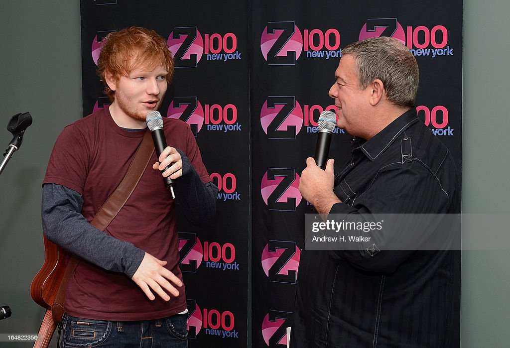 Elvis Duran (R) hosts a Z100 performance by Ed Sheeran at the Z100 Studio on March 28, 2013 in New York City.