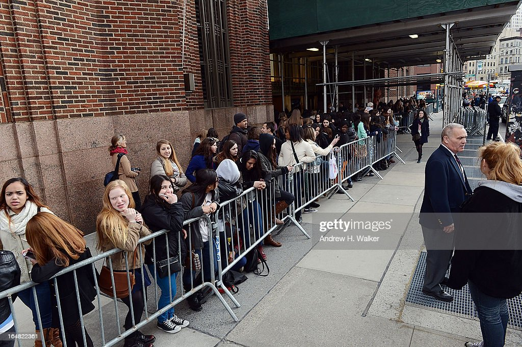 Elvis Duran hosts a Z100 performance by Ed Sheeran at the Z100 Studio on March 28, 2013 in New York City. Fans wait outside the Z100 Studio to try to see Ed Sheeran.