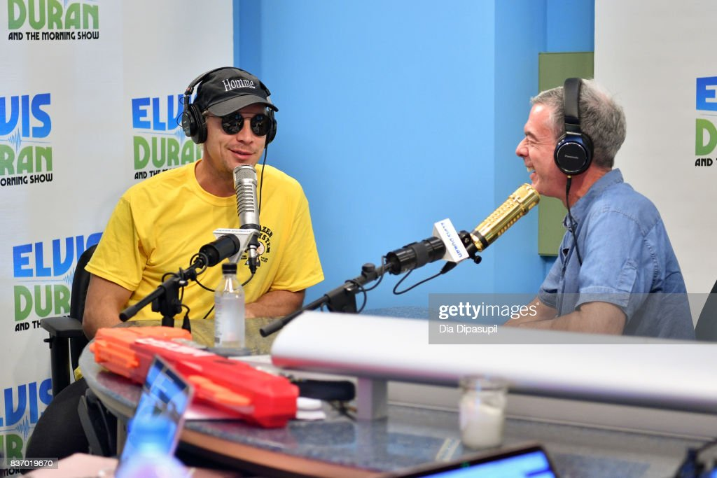 Elvis Duran (R) interviews Diplo during his visit to 'The Elvis Duran Z100 Morning Show' at Z100 Studio on August 22, 2017 in New York City.