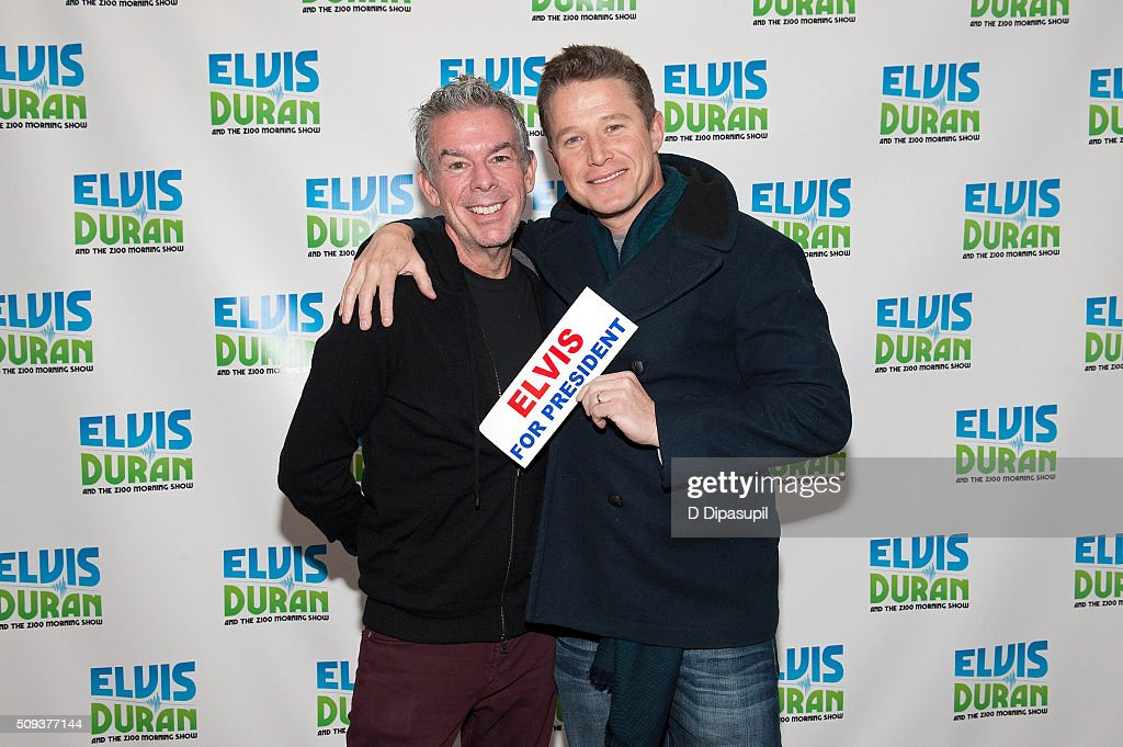 Elvis Duran (L) poses with Billy Bush during his visit to 'The Elvis Duran Z100 Morning Show' at Z100 Studio on February 10, 2016 in New York City.