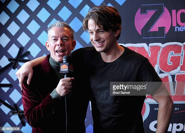 Elvis Duran speaks with Charlie Puth in the broadcast room at the Z100's Jingle Ball 2016 at Madison Square Garden on December 9 2016 in New York City