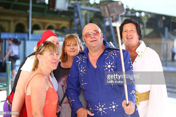 Elvis enthusiasts pose for an iPhone picture with a selfie stick as they wait for the Elvis Express headed to the 2015 Parkes Elvis Festival to...