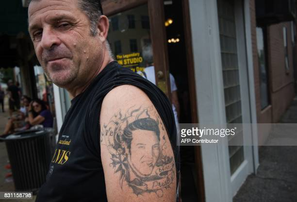 Elvis fan Eric Philiponska of France shows his tattoo of the King before visiting Sun Studio where Elvis Presley made his first recordings on August...